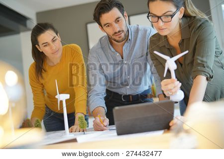 Attractive wind farm engineers looking over turbine placements