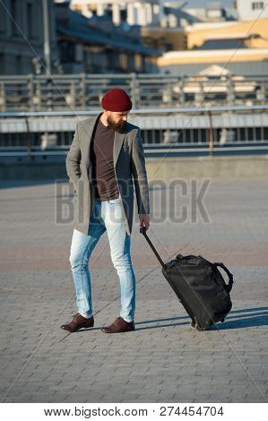 Adjust Living In New City. Traveler With Suitcase Arrive Airport Railway Station Urban Background. H