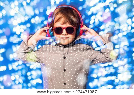 A young dj playing music in sunglasses. Merry Christmas and Happy New Year.