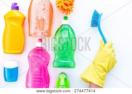 Housekeeping Set. Detergents, Soap, Cleaners And Brush For Housecleaning On White Background Top Vie