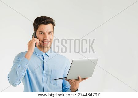 Young Hipster Businessman, Confident Staid Focus Looking In Computer While Handle Mobile Phone,  Por