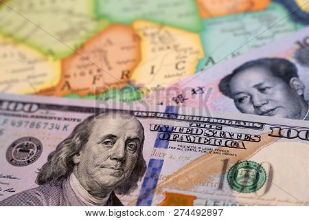 US dollars and chinese yuan on the map of Africa. Rivalry between the USA and China on the african continent, american and chinese investment, lending  economy poster