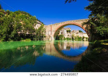 View Of Ancient Concordia Bridge In Fossombrone On Metauro River, Marche Region, Italy