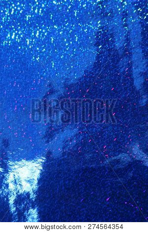 Blue Sparkle Background. Blue, Red, Gold, and Silver Sparkles. Sparkling colors. Wall Papers. Seamless background. Room for text. Room for text overlay. Holiday pattern. color background