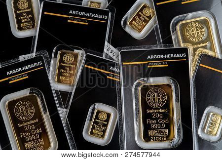 Kyiv, Ukraine - December 05, 2018: Several Small Minted Bars Of Different Weight Produced By The Swi