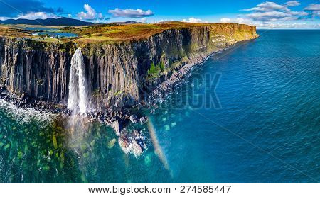 Aerial View Of The Dramatic Coastline At The Cliffs By Staffin With The Famous Kilt Rock Waterfall -