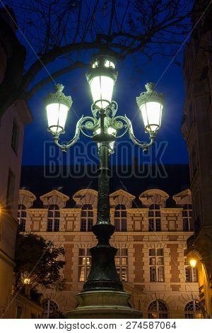 The Lamp Post On Place De Furstenberg At Night, Paris, France.