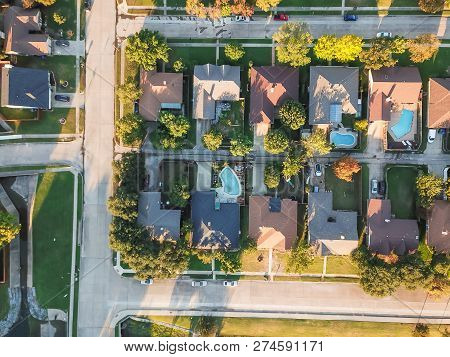 Top View Residential Dwelling Units With Swimming Pool In Fall Season Near Dallas, Texas