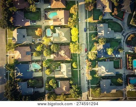Filtered Image Residential Dwelling Units With Swimming Pool In Fall Season Near Dallas, Texas