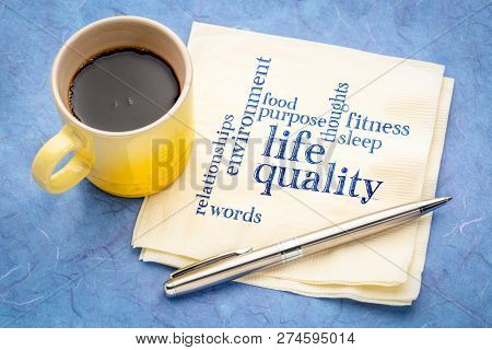 life quality concept - handwriting on a napkin with a cup of espresso coffee