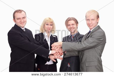 Top View Of Happy Business Colleagues With Their Hands Together Gesturing Unity