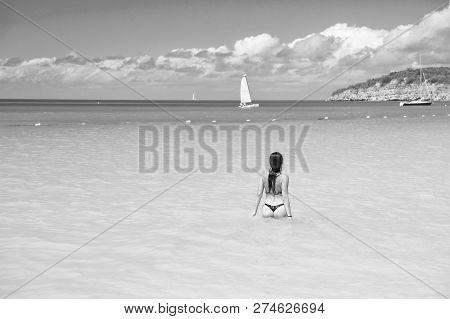 Girl Swimwear Azure Crystal Ocean Water Rear View. Vacation Luxury Ocean Beach Resort. Swim Through