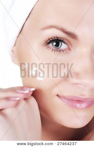 Girl applying cream
