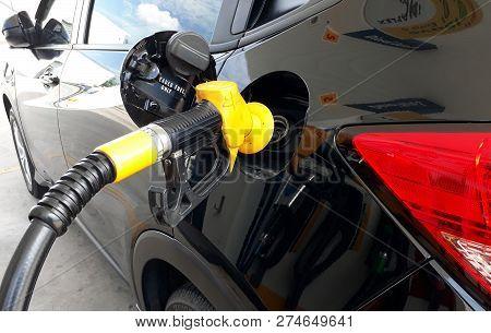 Shah Alam, Selangor, Malaysia - November 18,2018 : Black Honda (hrv) Car Pumping Fuel Using A Yellow