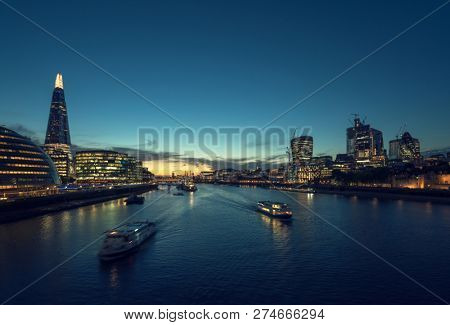 sunset in London, river Thames from Tower Bridge, UK