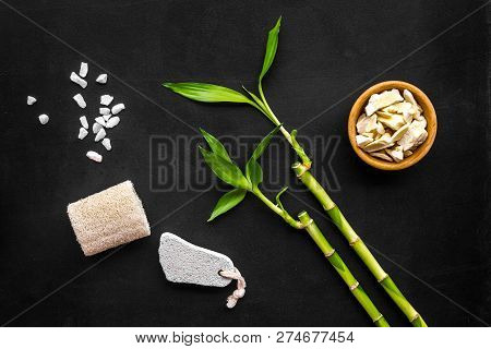 Asian Spa Background. Spa Treatment Concept. Bamboo Branch, Spa Cosmetics On Black Background Top Vi