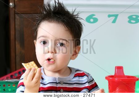Adorable Preschooler Eating Crackers