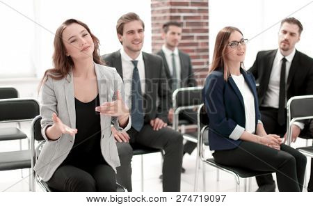 male and female colleagues discussing document at team meeting o