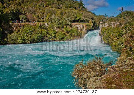 Beatiful Blue Water Beneath Of Huka Falls In Taupo In New Zealand