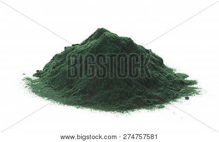 Close Up Of Organic Spirulina Powder Heap Over White Background.