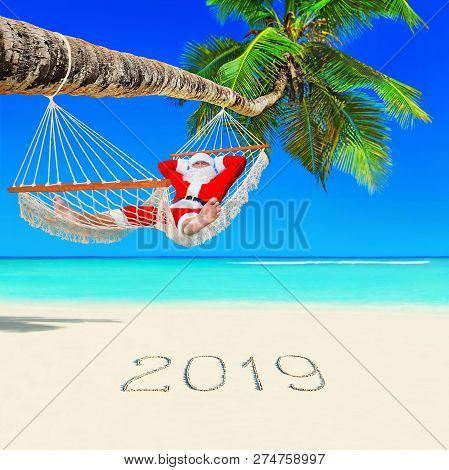 Santa Claus Relax In Mesh Hammock Under Coconut Palm Tree At Tropical Ocean Island Beach With 2019 H