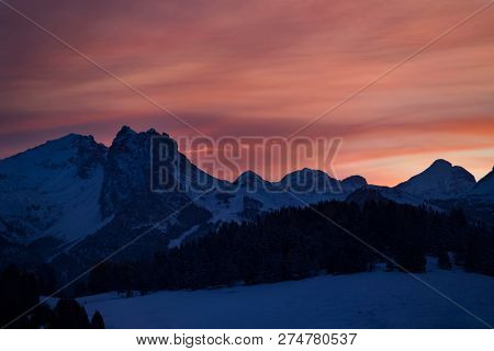 Beautiful sunrise in Dolomite mountains in Alpe di Siusil, Italy in winter.