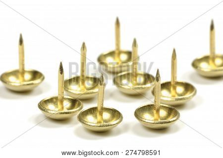 Burnished Brass Upholstery Tacks, French Natural Round Furniture Nails, Shiny Golden Yellow Style, Large Detailed Isolated Macro Closeup Studio Shot, Gentle Bokeh Shadows poster