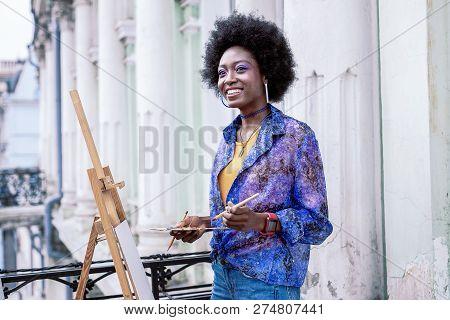 Stylish Artist Feeling Happy While Painting Landscape Outside
