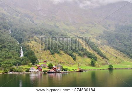 Main View Of Tuftofossen Waterfall And Tufto Farm In Norway. This Tinny Village Is Located On The We