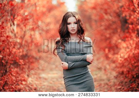 Young Sexy Woman With Long Hair In Grey Dress, In Coral Forest. Color Of The Year 2019. Main Trend N