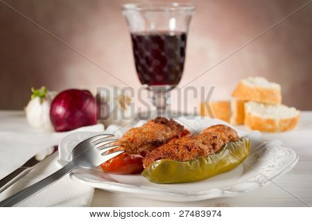 stuffer pepper on dish with red wine