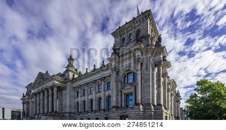 Reichstag building in Berlin, Germany. Under view, clouds travel on the sky background.