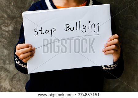 Girl With Stop Bullying Sign, Stop Bullying Concept. Bullying Is Unwanted And Aggressive Behavior. I
