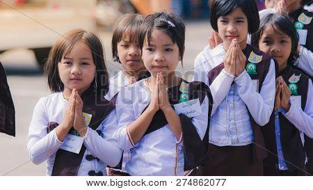 Taunggyi, Myanmar - November 06, 2017 :  Burmese Girl Wearing A White Dress To The Temple To Pray On