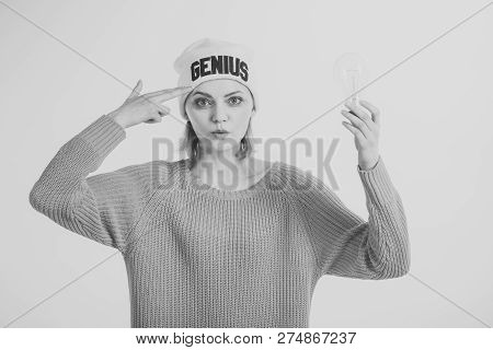 Woman Points On Head With Finger, Has Idea, White Background. Lady In Hat With Genius Word, Found Ou