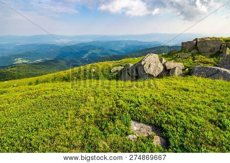 Grassy Slope With Huge Rocks. Wonderful Summer Landscape In Mountains. Grassy Slope With Huge Rocks.