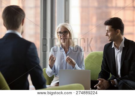 Middle Aged Company Owner Negotiating With Business Partners