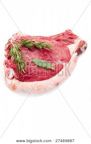 raw T-bone with herbs poster
