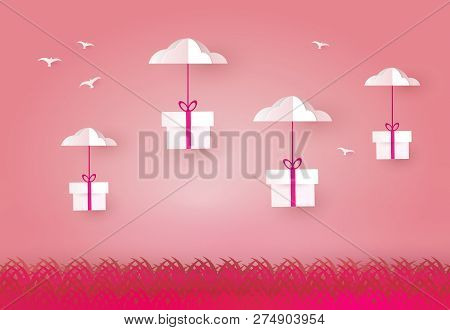 Gift Boxes Hanging On Clouds Sky. Paper Art