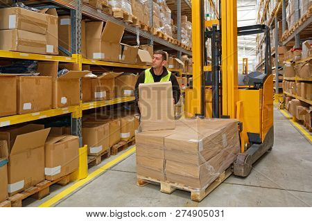Order Picking Worker With Box In Fulfillment Warehouse