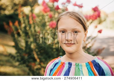 4bd9aa9196b7 Outdoor Portrait Of 10-12 Year Old Girl In Summer Park
