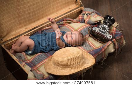 Happiness. Sweet Little Baby. New Life And Birth. Small Girl In Suitcase. Traveling And Adventure. F