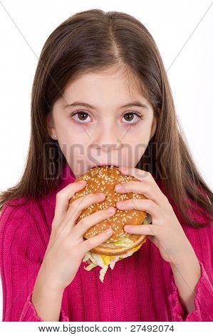 little girl eating hamburger