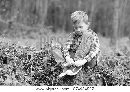 Promoting Child Development. Little Boy Relax In Woods. Little Boy Develop Physical Ability. Put Chi