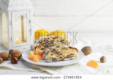 Christmas Fruit Cake Or Germany Christstollen With Tangerines, Nuts And A Burning Candle Lantern Aga