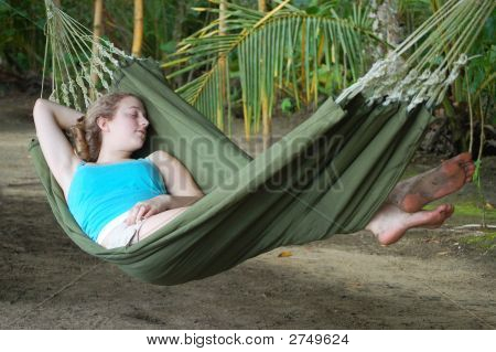 Young Woman Sleeping In A Hammock