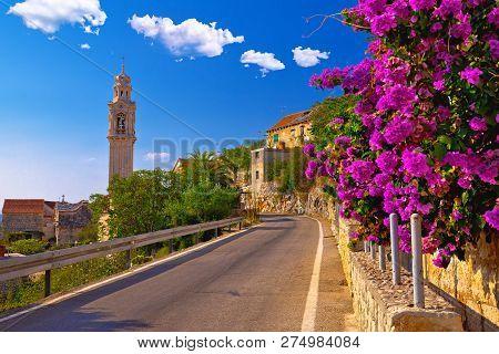 Village Of Lozisca On Brac Island Historic Street And Colofrul Flowers View, Dalmatia, Croatia