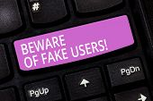 Text sign showing Beware Of Fake Users. Conceptual photo Be aware of safety and danger in online communications Keyboard key Intention to create computer message pressing keypad idea. poster