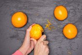 Woman hands are scraping orange zest. recipe step by step hot red mulled wine flatlay on grey stone poster