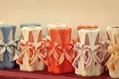 Decor, design, craft, decoration shop. Candles on shelf in decoration shop. Wick, paraffin or wax od various colors, decor. Sale, shop, shopping. poster
